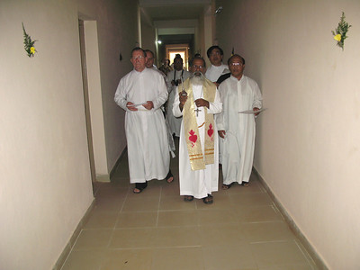 The Bishop enters the building to give his blessing.