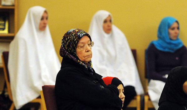 "Donna Mabrouk listens to the midday service on Friday.<br /> Muslims attend worship at the new location of the Islamic Center of Boulder at 55th Street and Baseline Rd.<br /> For more photos of the Islamic Center, go to  <a href=""http://www.dailycamera.com"">http://www.dailycamera.com</a>.<br /> Cliff Grassmick / November 11, 2011"