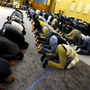 "Muslims attend worship at the new location of the Islamic Center of Boulder at 55th Street and Baseline Rd on Friday.<br /> For more photos of the Islamic Center, go to  <a href=""http://www.dailycamera.com"">http://www.dailycamera.com</a>.<br /> Cliff Grassmick / November 11, 2011"