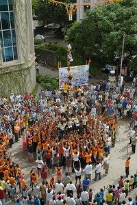 "Krishna Janamashtmi Celebrations in Hiranandani Gardens, Powai Lake, Mumbai. India. The objective is to make a human pyramid and break a ""handi"" (Pot) on the top much like Lord Krishna used to do."