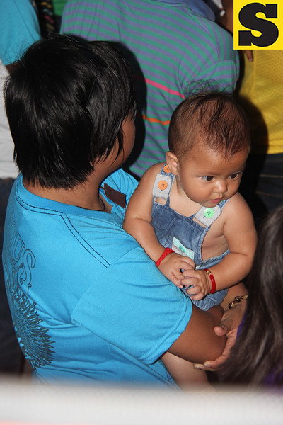 Baby joins the Good Friday procession in Bantayan Island, Cebu