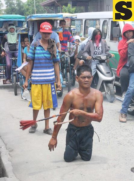 Polio victim BJ Marin makes his way to the 'Golgotha' in Barangay San Pedro Cutud during Good Friday's Maleldo 2012 rites.