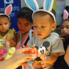 DAVAO. A child received an Easter egg from one of the stores inside SM City as part of the Easter Sunday celebration. (King Rodriguez)