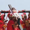PAMPANGA. Ruben Enaje, who played the role of Jesus Christ for the past 25 years, is nailed on the cross during the reenactment of Christ crucifixion in Cutud, City of San Fernando last year. (Chris Navarro)