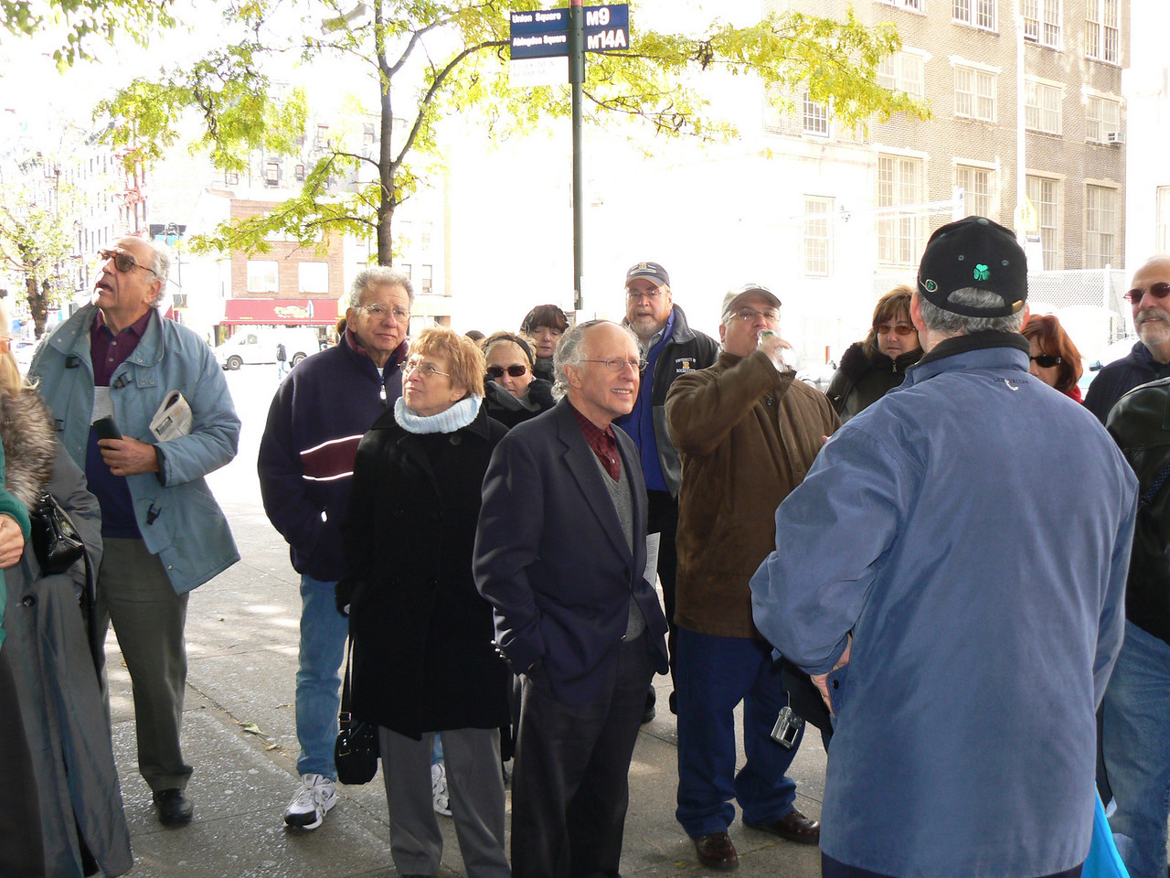 Listening to the guide in front of the Bnai Brith sign (next photo)