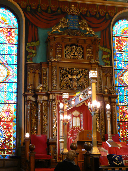 "Notice that the crown over the eagle says ""Keter Torah"", crown of the Torah; the one above the hands is clearly for Kohanim; and the top one with Judah's lions must be Kingship.  The guide said this ark was built in Italy at a time when it wouldn't have been politically wise to put Keter Torah on the top."