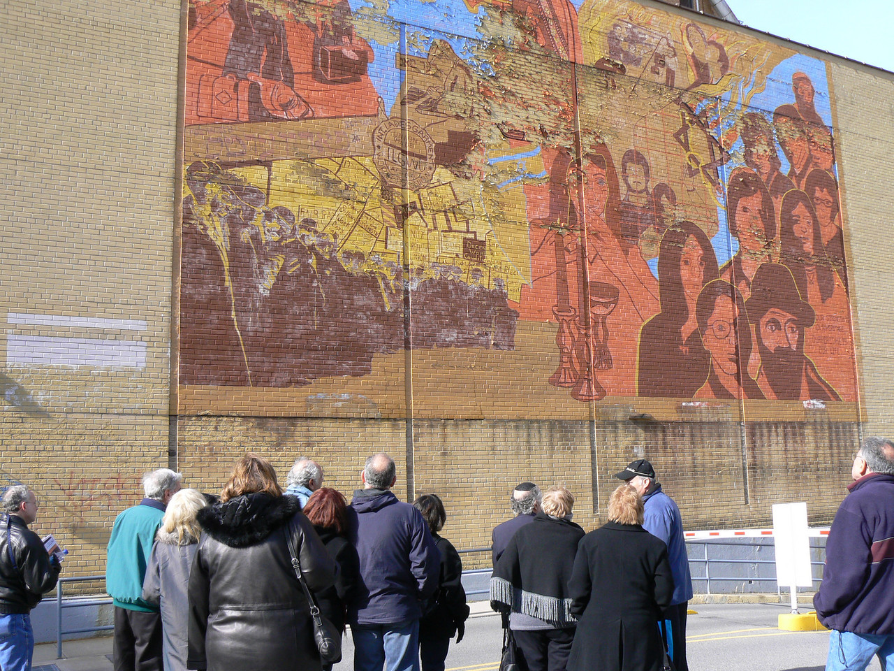Public art from the 60's - showing Russian immigrants on the right, a woman blessing Shabbat candles with a kiddish cup in the center, on the left commemoration of the Triangle shirt factory fire. The LESC is trying to get this restored/preserved.