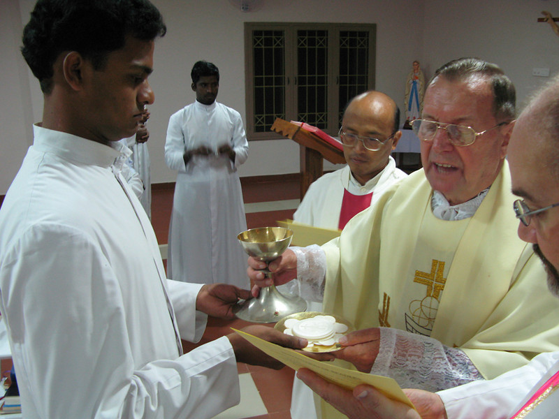 The chalice and hosts are presented to those who received the ministry of Acolyte.
