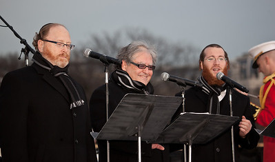 "Three world acclaimed cantors sing Chanukah songs - Yaacov Motzen, Jeffrey Nadel and Yaakov Lemmer. A special lighting ceremony took place for the National Hanukkah Menorah, the world's largest, on the Ellipse, just across from the White House on the first night of the eight-day Jewish holiday. The first candle was lit on Tuesday, December 20, 2011 by special guest, Office of Management and Budget Director Jacob Lew. ""The President's Own"" U.S. Marine Band, and ""The Three Cantors"" performed. The national menorah lighting dates to 1979 when Jimmy Carter was president. Hanukkah celebrates the Jewish Maccabees' military victory over Syrian oppression more than two-thousand years ago. A candle is lit each night of the eight-day celebration, commemorating the miracle of one day's supply of oil lasting a full eight days in the lamp following the rededication of the Holy Temple in Jerusalem. This annual event is sponsored by American Friends of Lubavitch (Chabad). (Photo by Jeff Malet)"