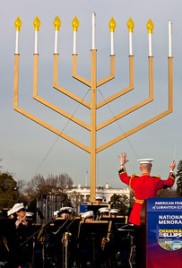 """The President's Own"" U.S. Marine Band performed at a special lighting ceremony for the National Hanukkah Menorah, the world's largest, on the Ellipse, just across from the White House on the first night of the eight-day Jewish holiday. The first candle was lit on Tuesday, December 20, 2011 by special guest, Office of Management and Budget Director Jacob Lew. The national menorah lighting dates to 1979 when Jimmy Carter was president. Hanukkah celebrates the Jewish Maccabees' military victory over Syrian oppression more than two-thousand years ago. A candle is lit each night of the eight-day celebration, commemorating the miracle of one day's supply of oil lasting a full eight days in the lamp following the rededication of the Holy Temple in Jerusalem. This annual event is sponsored by American Friends of Lubavitch (Chabad). (Photo by Jeff Malet)"