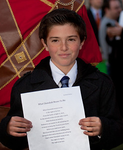"Rafael Shifren, 10, of Carmel Valley CA read his winning essay on the meaning of Hanukkah at a special lighting ceremony for the National Hanukkah Menorah, on the Ellipse, just across from the White House on the first night of the eight-day Jewish holiday.won the National Menorah Essay Contest. His essay was chosen the best among several thousand entries from Jewish elementary-school students across the country. The theme was ""What Hanukkah means to me."" The first candle was lit on Tuesday, December 20, 2011 by special guest, Office of Management and Budget Director Jacob Lew. ""The President's Own"" U.S. Marine Band, and ""The Three Cantors"" performed. The national menorah lighting dates to 1979 when Jimmy Carter was president. Hanukkah celebrates the Jewish Maccabees' military victory over Syrian oppression more than two-thousand years ago. A candle is lit each night of the eight-day celebration, commemorating the miracle of one day's supply of oil lasting a full eight days in the lamp following the rededication of the Holy Temple in Jerusalem. This annual event is sponsored by American Friends of Lubavitch (Chabad). (Photo by Jeff Malet)"