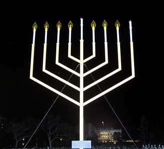"A special lighting ceremony took place for the National Hanukkah Menorah, the world's largest, on the Ellipse, just across from the White House on the first night of the eight-day Jewish holiday. The first candle was lit on Tuesday, December 20, 2011 by special guest, Office of Management and Budget Director Jacob Lew. ""The President's Own"" U.S. Marine Band, and ""The Three Cantors"" performed. The national menorah lighting dates to 1979 when Jimmy Carter was president. Hanukkah celebrates the Jewish Maccabees' military victory over Syrian oppression more than two-thousand years ago. A candle is lit each night of the eight-day celebration, commemorating the miracle of one day's supply of oil lasting a full eight days in the lamp following the rededication of the Holy Temple in Jerusalem. This annual event is sponsored by American Friends of Lubavitch (Chabad). (Photo by Jeff Malet)"