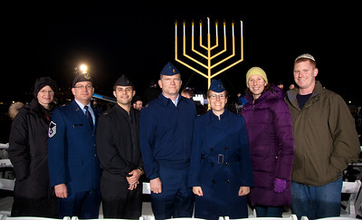 "Members of the Air Force and Navy from Andrews Air Force Base attend a special lighting ceremony for the National Hanukkah Menorah, the world's largest, on the Ellipse, just across from the White House on the first night of the eight-day Jewish holiday. The first candle was lit on Tuesday, December 20, 2011 by special guest, Office of Management and Budget Director Jacob Lew. ""The President's Own"" U.S. Marine Band, and ""The Three Cantors"" performed. The national menorah lighting dates to 1979 when Jimmy Carter was president. Hanukkah celebrates the Jewish Maccabees' military victory over Syrian oppression more than two-thousand years ago. A candle is lit each night of the eight-day celebration, commemorating the miracle of one day's supply of oil lasting a full eight days in the lamp following the rededication of the Holy Temple in Jerusalem. This annual event is sponsored by American Friends of Lubavitch (Chabad). (Photo by Jeff Malet)"