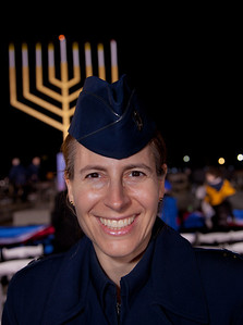 "Air Force Captain Rabbi Sarah Schechter attends a special lighting ceremony for the National Hanukkah Menorah, on the Ellipse, just across from the White House on the first night of the eight-day Jewish holiday. She was the first woman rabbi in the Air Force. The first candle was lit on Tuesday, December 20, 2011 by special guest, Office of Management and Budget Director Jacob Lew. ""The President's Own"" U.S. Marine Band, and ""The Three Cantors"" performed. The national menorah lighting dates to 1979 when Jimmy Carter was president. Hanukkah celebrates the Jewish Maccabees' military victory over Syrian oppression more than two-thousand years ago. A candle is lit each night of the eight-day celebration, commemorating the miracle of one day's supply of oil lasting a full eight days in the lamp following the rededication of the Holy Temple in Jerusalem. This annual event is sponsored by American Friends of Lubavitch (Chabad). (Photo by Jeff Malet)"