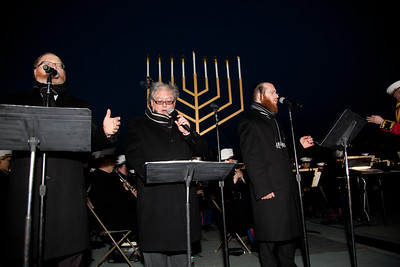 """Three world acclaimed cantors sing Hanukkah songs - Yaacov Motzen, Jeffrey Nadel and Yaakov Lemmer. A special lighting ceremony took place for the National Hanukkah Menorah, the world's largest, on the Ellipse, just across from the White House on the first night of the eight-day Jewish holiday. The first candle was lit on Tuesday, December 20, 2011 by special guest, Office of Management and Budget Director Jacob Lew. """"The President's Own"""" U.S. Marine Band, and """"The Three Cantors"""" performed. The national menorah lighting dates to 1979 when Jimmy Carter was president. Hanukkah celebrates the Jewish Maccabees' military victory over Syrian oppression more than two-thousand years ago. A candle is lit each night of the eight-day celebration, commemorating the miracle of one day's supply of oil lasting a full eight days in the lamp following the rededication of the Holy Temple in Jerusalem. This annual event is sponsored by American Friends of Lubavitch (Chabad). (Photo by Jeff Malet)"""