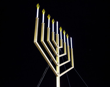 """A special lighting ceremony took place for the National Hanukkah Menorah, the world's largest, on the Ellipse, just across from the White House on the first night of the eight-day Jewish holiday. The first candle was lit on Tuesday, December 20, 2011 by special guest, Office of Management and Budget Director Jacob Lew. """"The President's Own"""" U.S. Marine Band, and """"The Three Cantors"""" performed. The national menorah lighting dates to 1979 when Jimmy Carter was president. Hanukkah celebrates the Jewish Maccabees' military victory over Syrian oppression more than two-thousand years ago. A candle is lit each night of the eight-day celebration, commemorating the miracle of one day's supply of oil lasting a full eight days in the lamp following the rededication of the Holy Temple in Jerusalem. This annual event is sponsored by American Friends of Lubavitch (Chabad). (Photo by Jeff Malet)"""