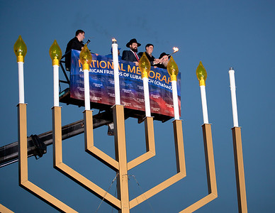 "Rabbi Levi Shemtov, Office of Management and Budget Director Jacob J. Lew and Shemtov's father, Rabbi Abraham Shemtov, light the National Menorah. A special lighting ceremony took place for the National Hanukkah Menorah, the world's largest, on the Ellipse, just across from the White House on the first night of the eight-day Jewish holiday. The first candle was lit on Tuesday, December 20, 2011. ""The President's Own"" U.S. Marine Band, and ""The Three Cantors"" performed. The national menorah lighting dates to 1979 when Jimmy Carter was president. Hanukkah celebrates the Jewish Maccabees' military victory over Syrian oppression more than two-thousand years ago. A candle is lit each night of the eight-day celebration, commemorating the miracle of one day's supply of oil lasting a full eight days in the lamp following the rededication of the Holy Temple in Jerusalem. This annual event is sponsored by American Friends of Lubavitch (Chabad). (Photo by Jeff Malet)"