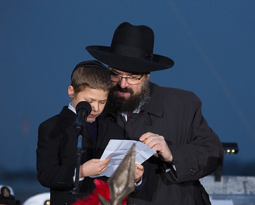 One to the two winners of the Rabbi Mendy Deren Memorial National Menorah Essay Contest, Dovid Moritz (9) of Pittsburgh, PA  Rabbi Levi Shemtov