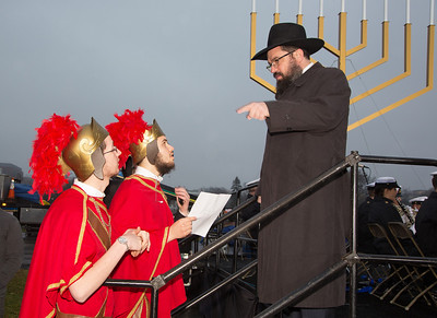 The Macabees, Zalman Debinsky, Mendy Schapiro and David Glassner take instructions from Rabbi Levi Shemtov