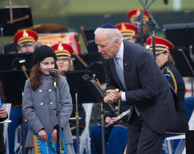 Vice President Joe Biden talks to Basya Fogelman, 9, of Wilkes Barre, Pa.  Simmy Hershkop, 11, of Wooster, Ma., and Basya Fogelman, read their winning essays on what Hanukkah means to them as they participate in the annual National Menorah Lighting during a ceremony marking the start of the celebration of Hanukkah, on the Ellipse near the White House in Washington, Tuesday, Dec. 16, 2014.
