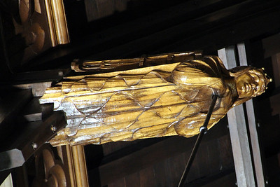 Roof detail - an angel from which a light fitting is suspended - at Glasgow University Memorial Chapel. 25 September 2011