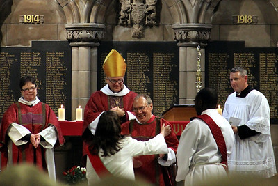 Newly ordained Kevin being greeted by other Deacons, watched by +Gregor and the Diocesian Ministerial Development Officer. 25 September 2011