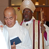 Receiving Lito Santos into Episcopal Priesthood