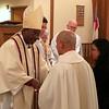 Receiving Lito Santos into Episcopal Priesthood