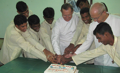 The traditional cutting of the cake.
