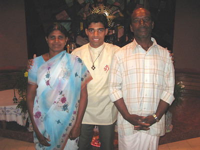 Praveen, with his parents.