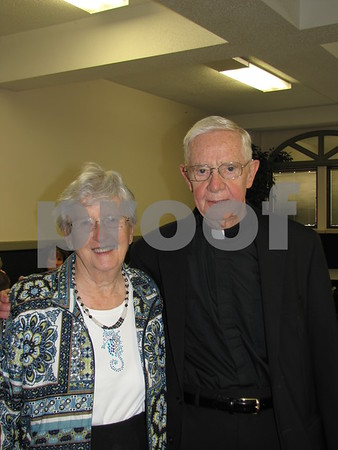Ellen Flaherty with Msgr. Mervin Hood.