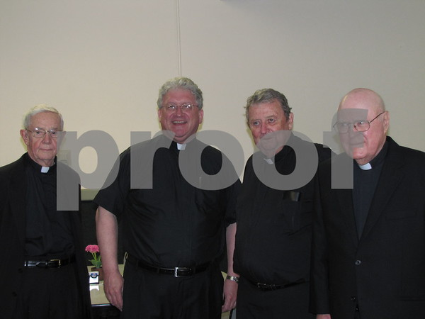 Msgr. Mervin Hood, Msgr. Kevin McCoy, Father Jim McAlpin, and Msgr. Tom Donahoe.