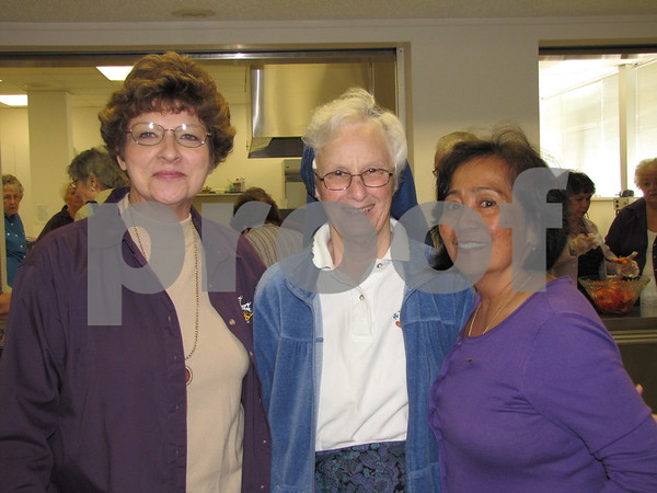 Barb Pessica, Sister Trudy Keefe, and Ida Burleson.  Pessica and Burleson are members of the Catholic Daughters of America.