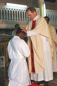 After the ordination, Fr. Martin lays his hands on Fr. Thomas' head.