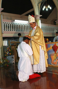 Deacon Thomas is ordained a priest, as the bishop lays his hands on his head, in silence.