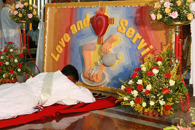 Laying prostrate during the singing of the Litany of Saints.