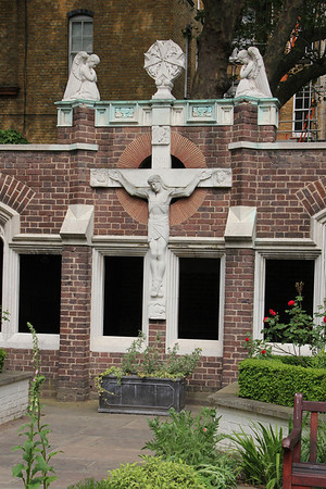 Crucifix and angels in the garden of the Priory Church of St John. 23 May 2012