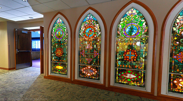 HIstoric stained glass panels find there way to a third setting in the church's 100 year plus history!