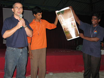 Fr. Andrew gives an address, presenting gifts to the SCJ India District from the SCJ Philippine District.