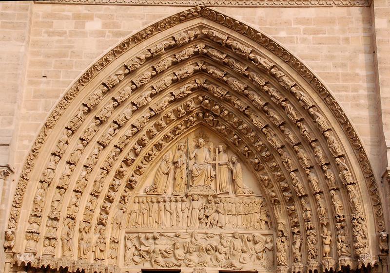 Order (or receding arch) over Portal--Notre Dame (Paris, France)