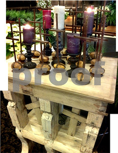 Advent candles on a table built from wood of a tornado-damaged steeple.