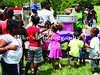 Shunta Graham worked the cotton candy machine as children waited for cotton candy, popcorn and snow cones at The Resurrection block party at God's Way Church on Commerce Road. /Mike Adam