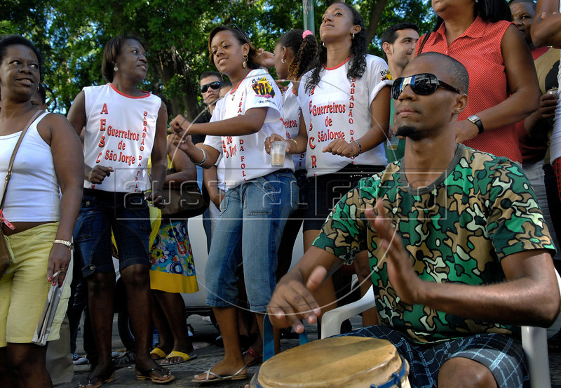 Worshippers of Candomble dance during celebration of Saint George's Day, Rio de Janeiro, Brazil, April 23, 2008. Thousands of Catholics and worshippers of Afro-Brazilian religions pack churches dedicated to Saint George, widely venerated in Brazil as the African deity Ogum, the warrior god.  (Austral Foto/Renzo Gostoli)