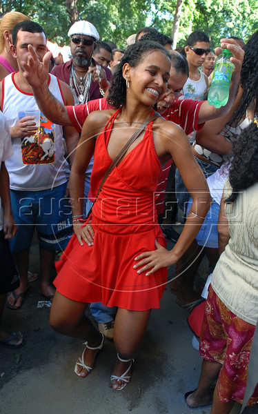 People dance in front of Saint George Church during celebration of Saint George's Day, Rio de Janeiro, Brazil, April 23, 2008. Thousands of Catholics and worshippers of Afro-Brazilian religions pack churches dedicated to Saint George, widely venerated in Brazil as the African deity Ogum, the warrior god.  (Austral Foto/Renzo Gostoli)