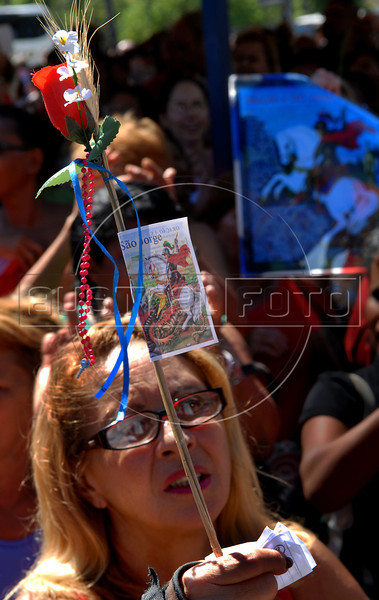 A woman prays during celebration of Saint George's Day, Rio de Janeiro, Brazil, April 23, 2008. Thousands of Catholics and worshippers of Afro-Brazilian religions pack churches dedicated to Saint George, widely venerated in Brazil as the African deity Ogum, the warrior god.  (Austral Foto/Renzo Gostoli)