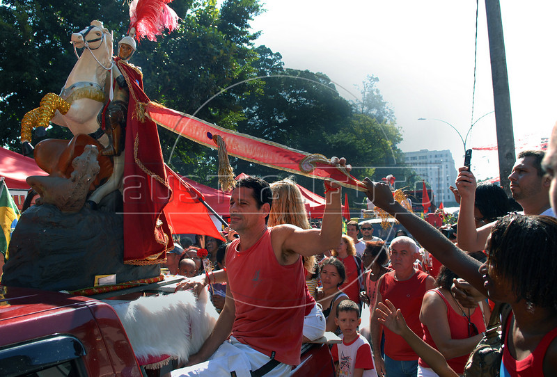 Faithfuls participate at a procession  in front of a catholic church during celebrations of Saint George's Day, Rio de Janeiro, Brazil, April 23, 2009. Thousands of Catholics and worshippers of Afro-Brazilian religions pack churches dedicated to Saint George, widely venerated in Brazil as the African deity Ogum, the warrior god. (Austral Foto/Renzo Gostoli)