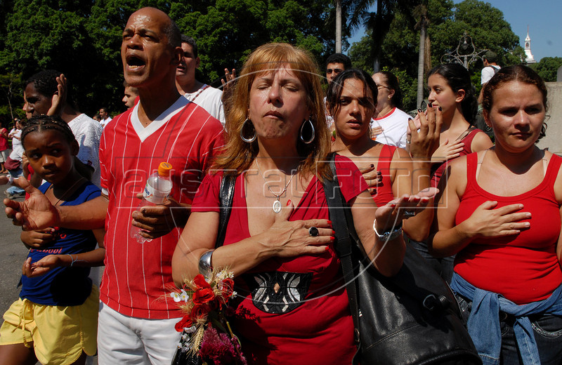 Devotees of Afro-American religion participate at a cult in front of a catholic church during celebrations of Saint George's Day, Rio de Janeiro, Brazil, April 23, 2009. Thousands of Catholics and worshippers of Afro-Brazilian religions pack churches dedicated to Saint George, widely venerated in Brazil as the African deity Ogum, the warrior god. (Austral Foto/Renzo Gostoli)
