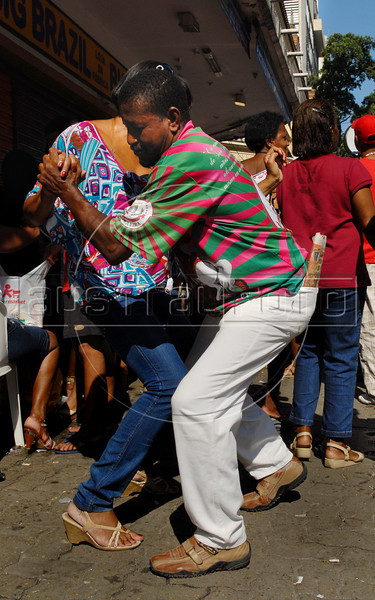 A couple dance in front of Saint George Church in Rio de Janeiro, Brazil during celebration of Saint George's Day, April 23, 2006. Thousands of Catholics and worshippers of Afro-Brazilian religions pack churches dedicated to Saint George, widely venerated in Brazil as the African deity Ogum, the warrior god.  (Austral Foto/Renzo Gostoli)