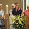 Sister Marla pronouncing her vows; to her left, Sister Florence Seifert, witnesses Sisters Mary Garke and Mary Ellen Andrisin. Photo by Pat Morrison