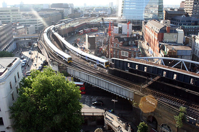 2 June 2011 The forecourt/bus station at London Bridge, with city bound trains leaving the high level platforms, viewed from the tower of Southwark Cathedral